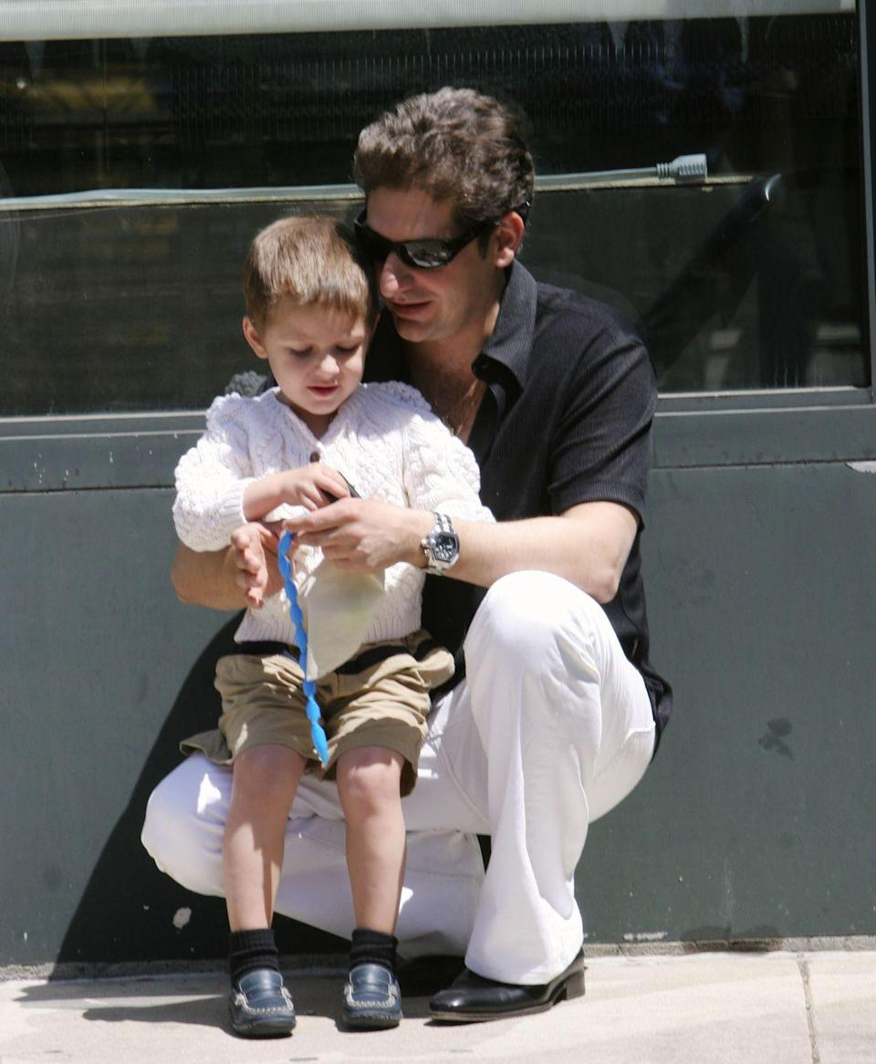 <p>James Gandolfini wasn't the only one to bring his child to set. Michael Imperioli, who played Christopher Moltisanti, plays with his son during a taping in New York City in 2005. </p>