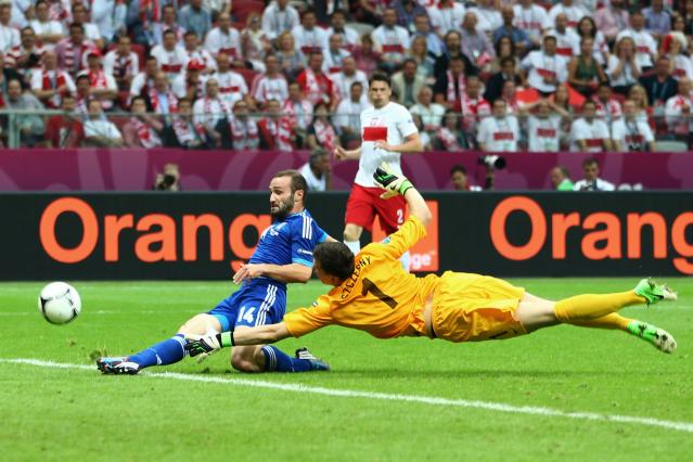 WARSAW, POLAND - JUNE 08: Wojciech Szczesny of Poland fails to stop Dimitris Salpigidis of Greece score the equalising goal during the UEFA EURO 2012 group A match between Poland and Greece at The National Stadium on June 8, 2012 in Warsaw, Poland. (Photo by Michael Steele/Getty Images)