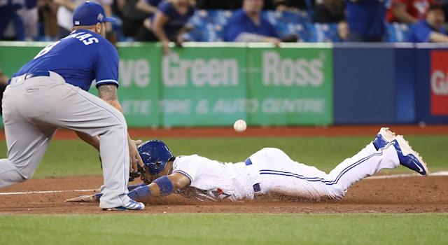 Devon Travis has had a rough start to the year, but he does some of the little things that help the Blue Jays win. (Photo by Tom Szczerbowski/Getty Images)
