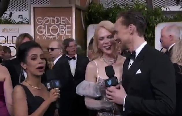 Tom then began interviewing Nicole while the reported looked on.