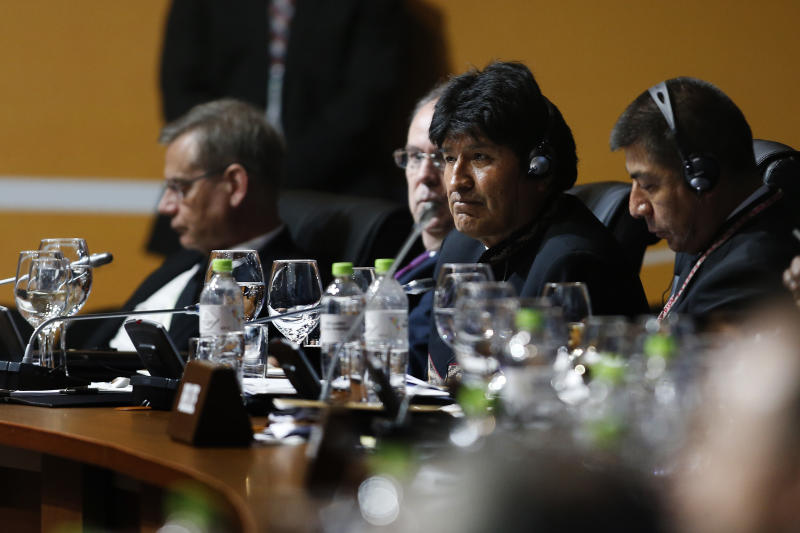 Bolivia's President Evo Morales, second right, attends the plenary session at the Americas Summit in Lima, Peru, Saturday, April 14, 2018.(AP Photo/Karel Navarro)