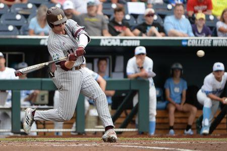 Jun 19, 2018; Omaha, NE, USA; Mississippi State Bulldogs designated hitter Jordan Westburg (11) hits a grand slam home run in the second inning against the North Carolina Tar Heels in the College World Series at TD Ameritrade Park. Mandatory Credit: Steven Branscombe-USA TODAY Sports