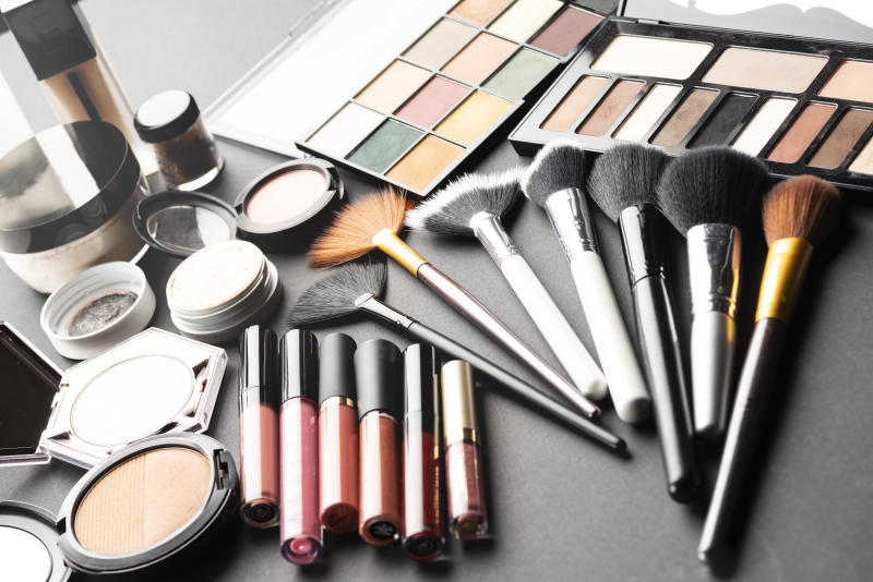 Multiple cosmetic products on black background. High resolution image for cosmetics and fashion industry.