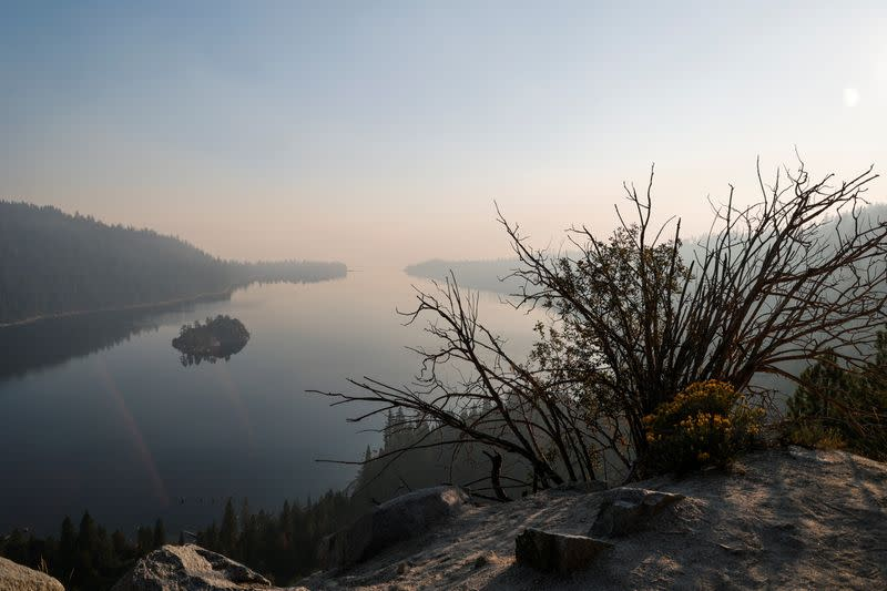A view from Emerald Bay towards Lake Tahoe is obscured by smoke from the Caldor Fire viewed from Georgetown