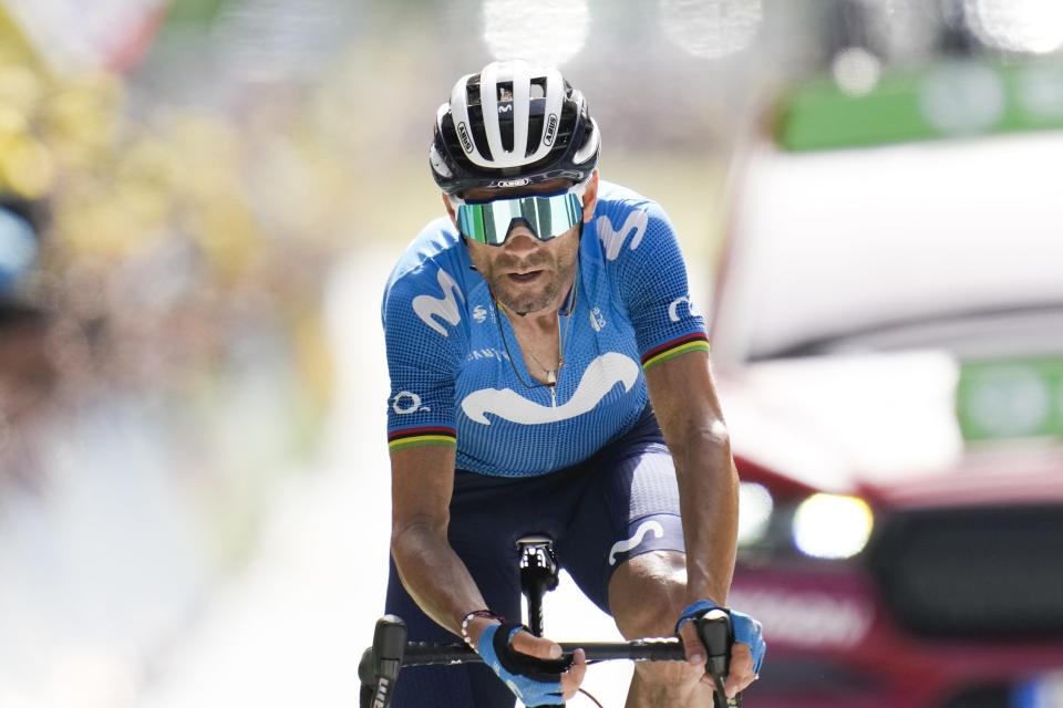 Spain's Alejandro Valverde crosses the finish line in second place during the fifteenth stage of the Tour de France cycling race over 191.3 kilometers (118.9 miles) with start in Ceret and finish in Andorra-la-Vella, Andorra, Sunday, July 11, 2021. (AP Photo/Christophe Ena)