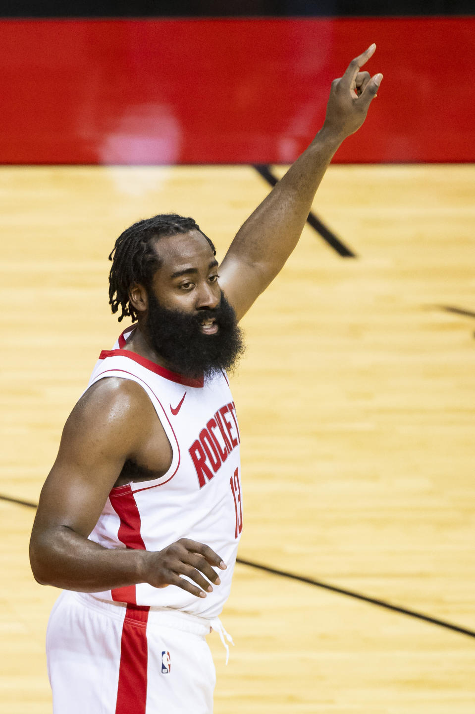 Houston Rockets guard James Harden (13) yells directions to his team during the third quarter of a preseason NBA basketball game against the San Antonio Spurs, Thursday, Dec. 17, 2020, in Houston. (Mark Mulligan/Houston Chronicle via AP)