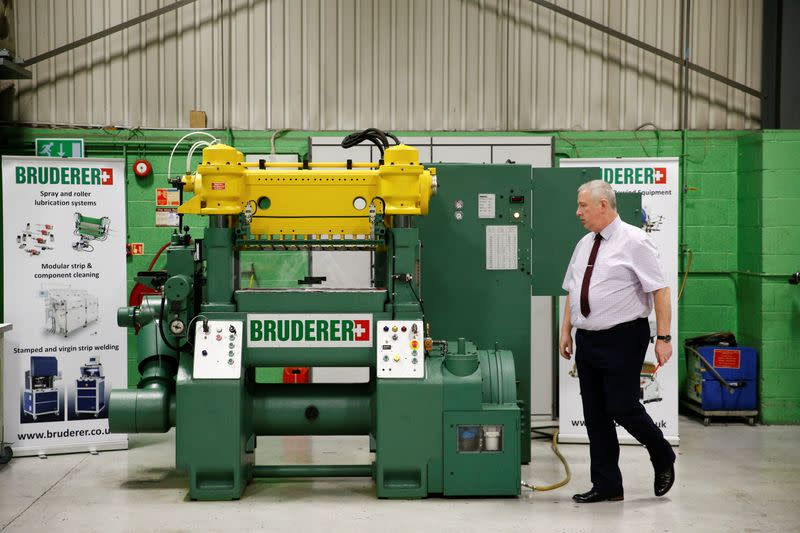 Service Manager of Bruderer Uk Ltd Mark Crawford, inspects a machine at the company's factory in Luton