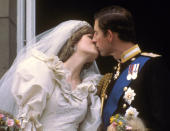 """FILE - In this July 29, 1981 file photo, Britain's Prince Charles kisses his bride, Princess Diana, on the balcony of Buckingham Palace in London, after their wedding.For someone who began her life in the spotlight as """"Shy Di,"""" Princess Diana became an unlikely, revolutionary during her years in the House of Windsor. She helped modernize the monarchy by making it more personal, changing the way the royal family related to people. By interacting more intimately with the public -- kneeling to the level of children, sitting on edge of a patient's hospital bed, writing personal notes to her fans -- she set an example that has been followed by other royals as the monarchy worked to become more human and remain relevant in the 21st century. (AP Photo/File)"""