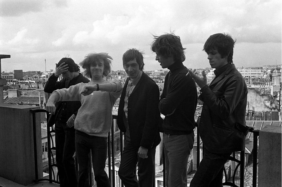 <p>The iconic rock group goofs off on a Paris rooftop. In April, they played multiple shows at L'Olympia, as part of their 1965 European tour. </p>