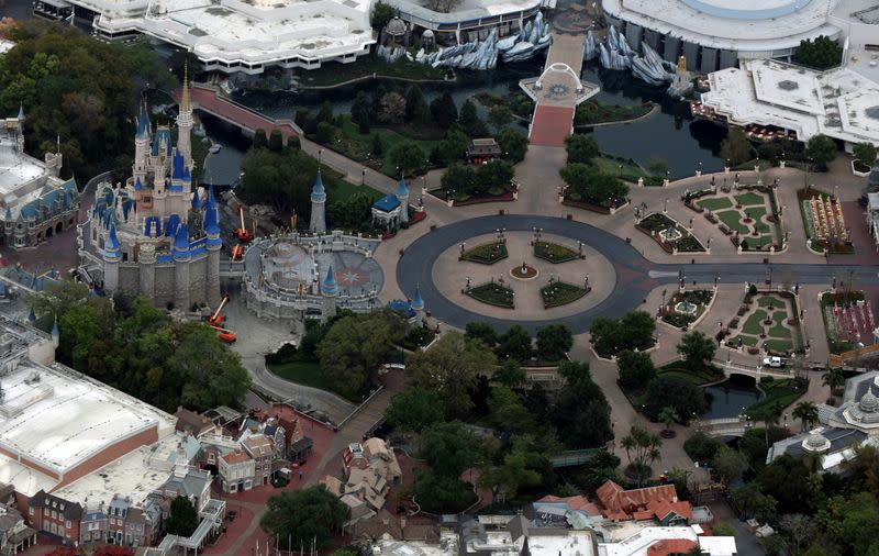 FILE PHOTO: Disney's Magic Kingdom theme park sits empty after it closed in an effort to combat the spread of coronavirus disease (COVID-19) in Orlando