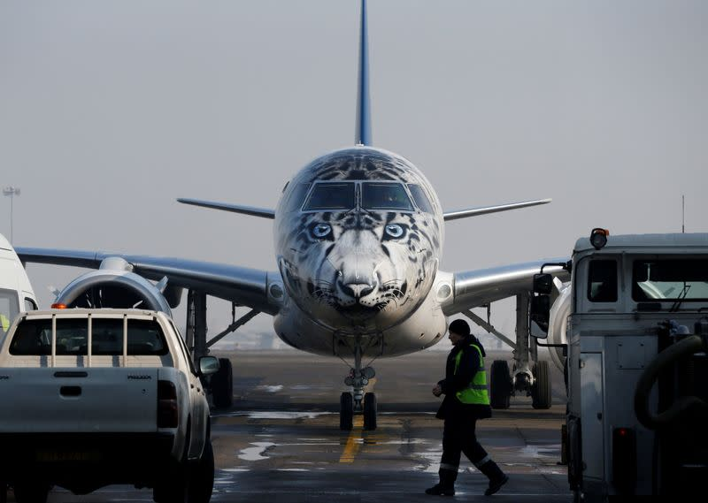 FILE PHOTO: Air Astana Embraer E190-E2 aircraft with a snow leopard livery is seen at Almaty International Airport