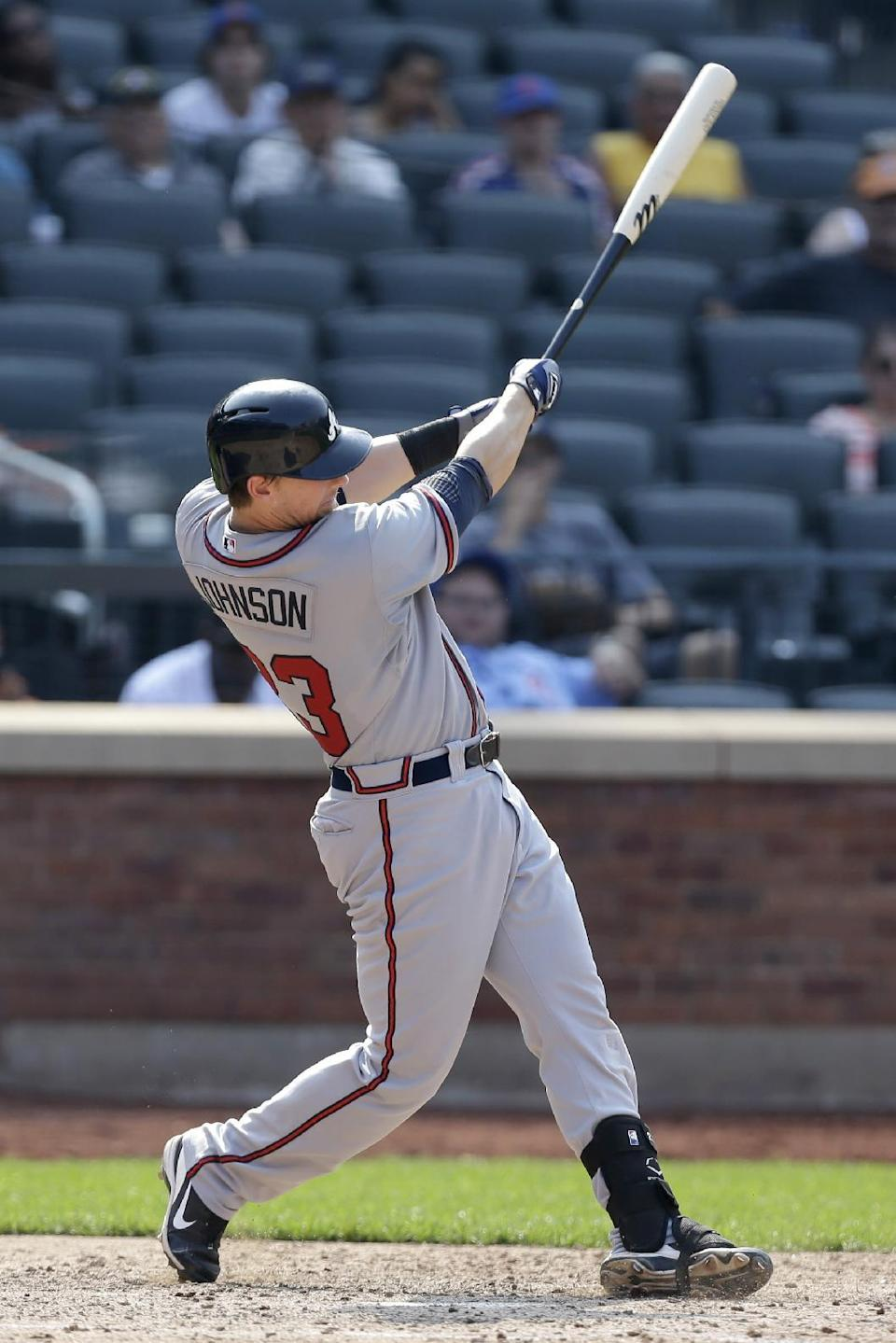 Atlanta Braves' Chris Johnson hits a three-run home run during the 10th inning of the baseball game New York Mets at Citi Field Wednesday, Aug. 21, 2013 in New York. The Braves won 4-1. (AP Photo/Seth Wenig)