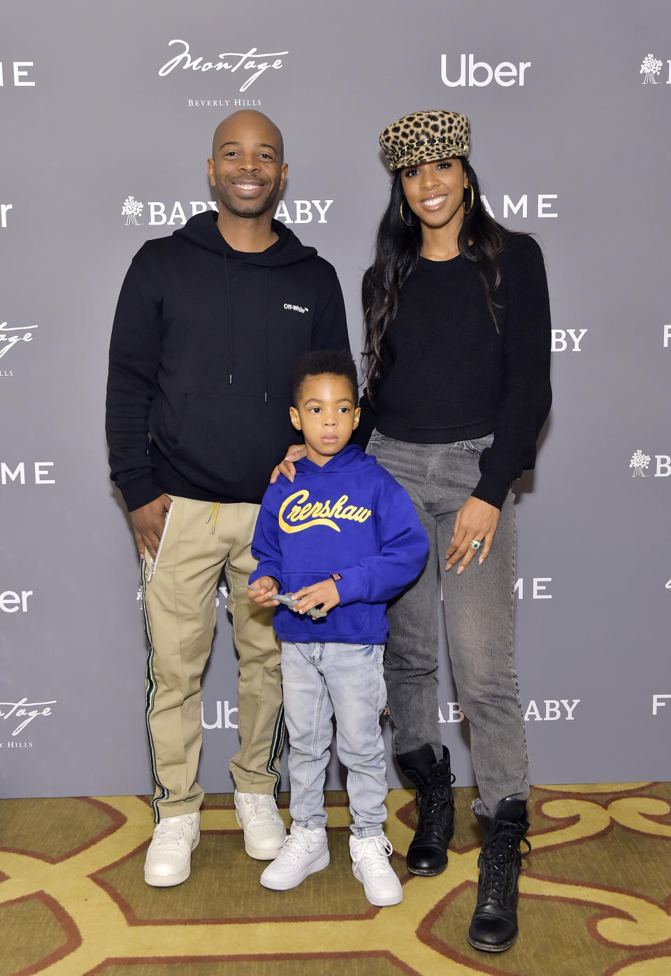 Tim Weatherspoon, Titan Jewell Weatherspoon and Kelly Rowland attend The Baby2Baby Holiday Party Presented By FRAME And Uber at Montage Beverly Hills on December 15, 2019 in Beverly Hills, California. (Photo by Stefanie Keenan/Getty Images for Baby2Baby)