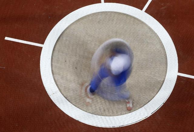 Italy's Nicola Vizzon competes in the men's hammer throw final during the London 2012 Olympic Games at the Olympic Stadium, Sunday, Aug. 5, 2012, in London. (AP Photo/Fabrizio Bensch, Pool)