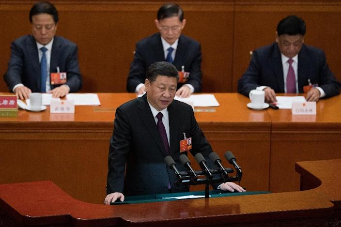 """Chinese President Xi Jinping warned in March that """"all acts and tricks to separate the country are doomed to fail"""" (AFP Photo/NICOLAS ASFOURI)"""