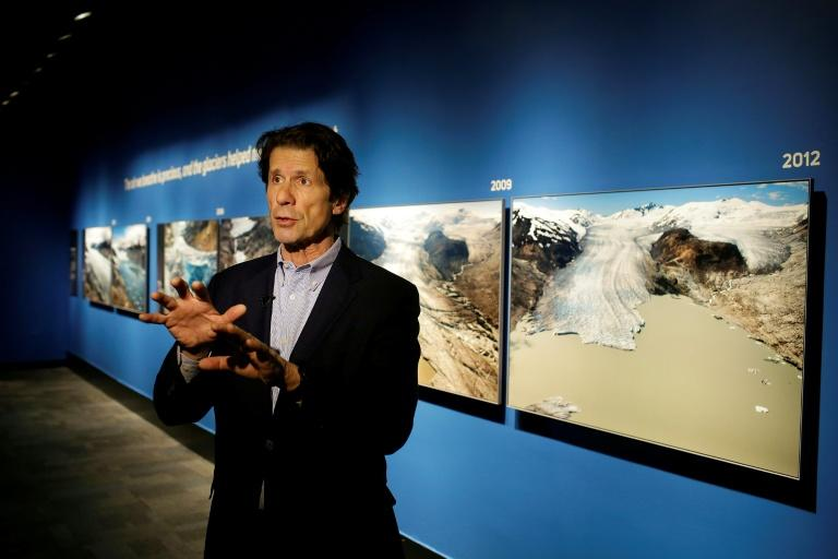 "US photographer James Balog speaks about his images at the ""Extreme Ice"" exhibit at the Museum of Science and Industry in Chicago, Illinois"