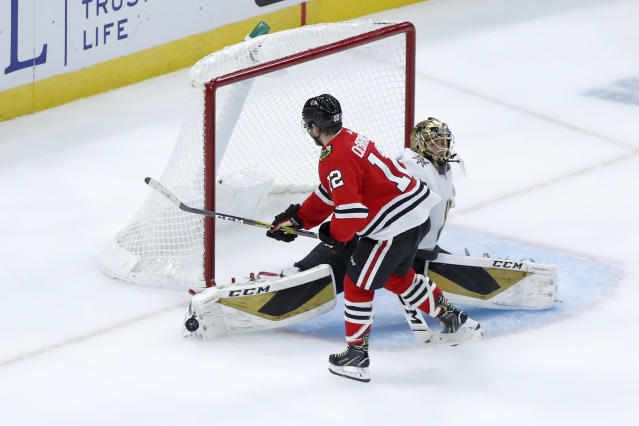 Vegas Golden Knights goaltender Marc-Andre Fleury makes a save on a shot by Chicago Blackhawks right wing Alex DeBrincat during the shootout in an NHL hockey game Tuesday, Oct. 22, 2019, in Chicago. The Golden Knights won 2-1. (AP Photo/Charles Rex Arbogast)