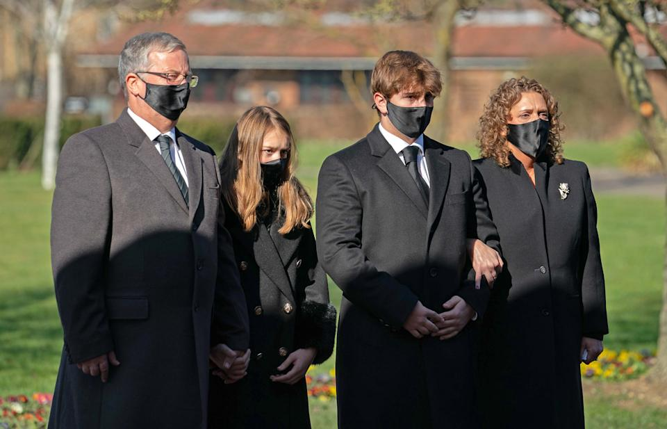 BEDFORD, ENGLAND - FEBRUARY 27: (No reuse after 11.59pm on March 6th 2021 without written consent from gemma@captaintom.org.) The family of Captain Sir Tom Moore (left to right) son-in-law Colin Ingram, granddaughter Georgia, grandson Benjie and daughter Hannah Ingram-Moore arrive for his funeral at Bedford Crematorium on February 27, 2021 in Bedford, England. WWII veteran, Sir Tom raised nearly £33 million for NHS charities ahead of his 100th birthday last year by walking laps of his garden in Marston Moretaine, Bedfordshire. He died on the 2nd of February after testing positive for COVID-19. (Photo by Joe Giddens - Pool/Getty Images)