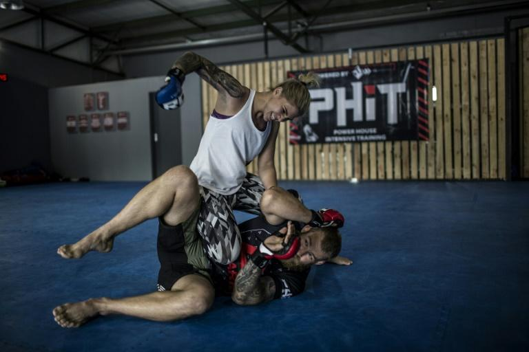 Shana Power, 25, Mixed Martial Artist, spars with a male champion in the gym which she co-owns called Power House Intensive Training in Johannesburg