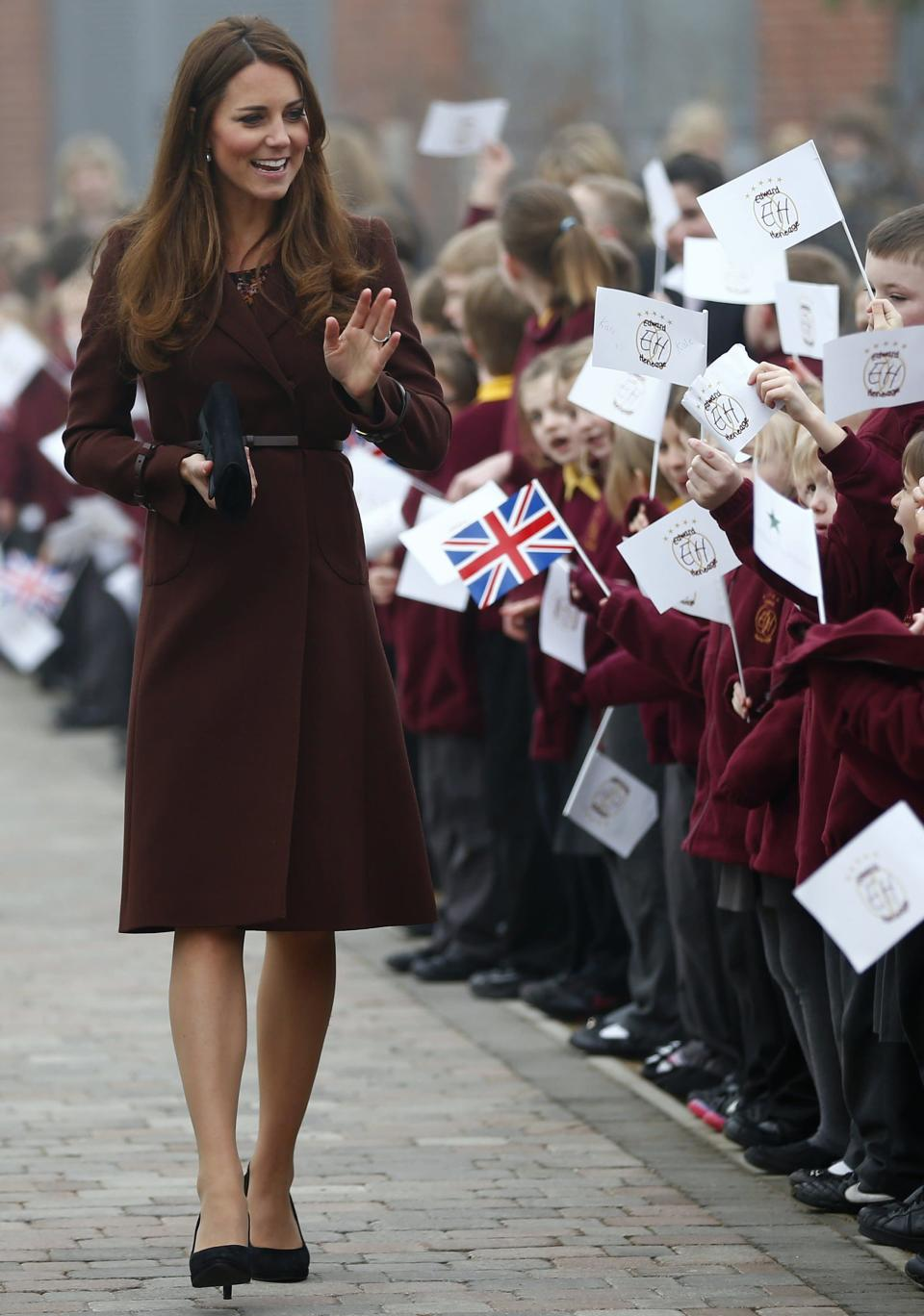 <p>On a visit to Grimsby, Kate recycled her £369 Hobbs coat from the previous year. She teamed the chestnut-hued number with a dress by London-based label, Great Plains. <em>[Photo: Getty]</em> </p>