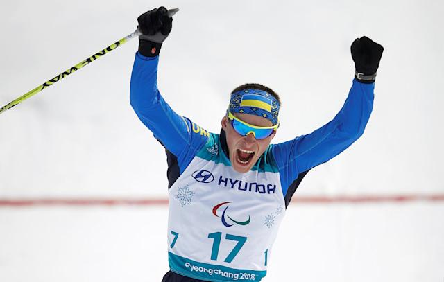 Cross-Country Skiing - Pyeongchang 2018 Winter Paralympics - Men's 20km Free - Standing - Alpensia Biathlon Centre - Pyeongchang, South Korea - March 12, 2018 - Ihor Reptyukh of Ukraine reacts after crossing the finishing line to win first place. REUTERS/Carl Recine
