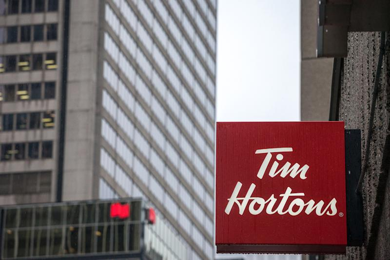 Picture of a sign with the logo of Tim Hortons on their main cafe for North Montreal, Quebec, Canada. Tim Horton's is a multinational fast food restaurant known for its coffee and donuts. It is also Canada's largest quick service restaurant chain