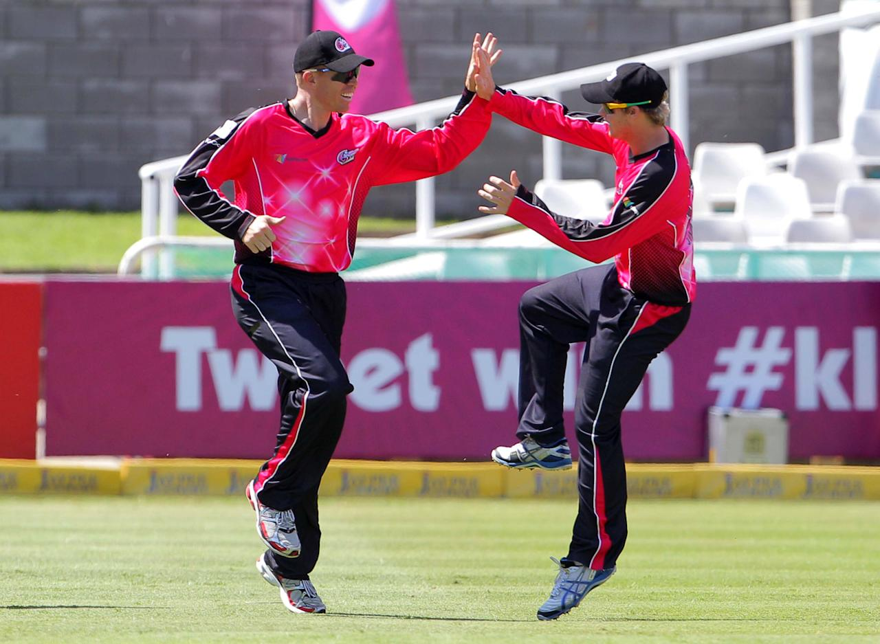 CAPE TOWN, SOUTH AFRCA - OCTOBER 16:  Dominic Thornely (L) of the Sydney Sixers celebrates during the Champions League twenty20 match between Sydney Sixers (Australia) and Yorkshire (England) at Sahara Park Newlands on October 16, 2012 in Cape Town, South Africa. (Photo by Carl Fourie / Gallo Images/Getty Images)