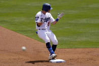 Los Angeles Dodgers' Zach McKinstry celebrates after hitting an RBI double as the ball is thrown back in during the second inning of a baseball game against the Washington Nationals Sunday, April 11, 2021, in Los Angeles. (AP Photo/Mark J. Terrill)
