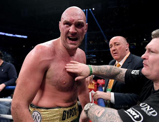 Tyson Fury at the end of a 12-round draw with Deontay Wilder in a WBC heavyweight world title bout on December 1, 2018 (AFP Photo/Harry How)