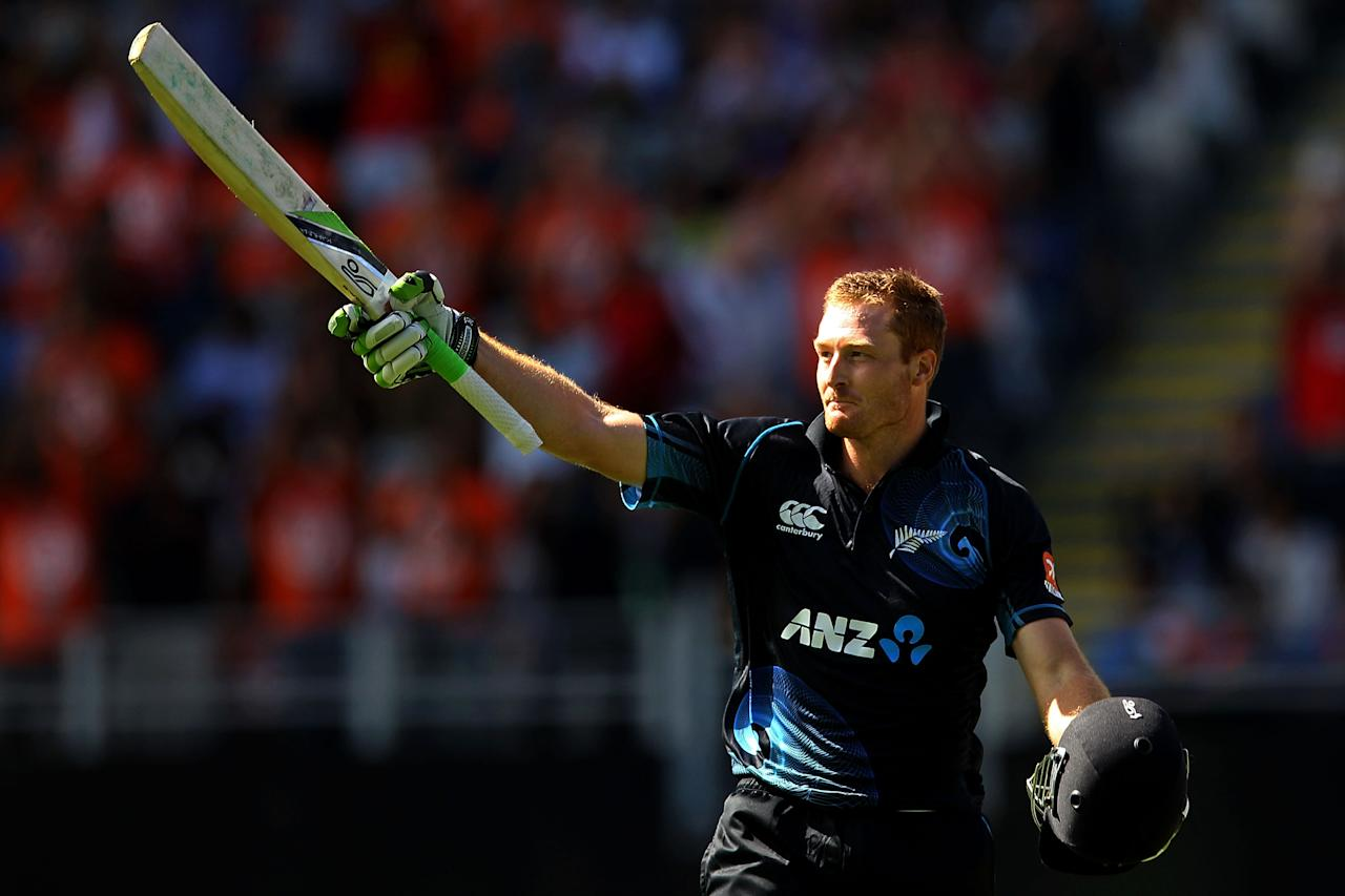 AUCKLAND, NEW ZEALAND - JANUARY 25: Martin Guptill of New Zealand celebrates his century during the One Day International match between New Zealand and India at Eden Park on January 25, 2014 in Auckland, New Zealand.  (Photo by Anthony Au-Yeung/Getty Images)