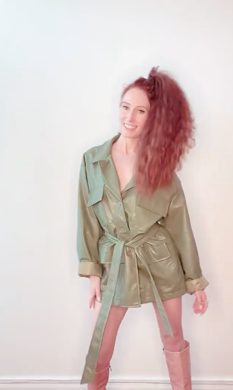 MAFS star Belinda Vickers models Nasty Gal Patent Faux Leather Longline Belted Jacket