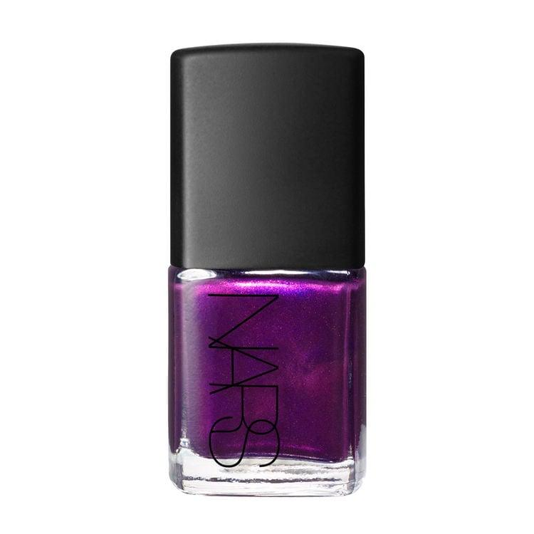 "<p>The moody violet hue of the <a href=""https://www.popsugar.com/buy/NARS-Nail-Polish-Purple-Rain-477959?p_name=NARS%20Nail%20Polish%20in%20Purple%20Rain&retailer=narscosmetics.com&pid=477959&price=20&evar1=bella%3Auk&evar9=46481480&evar98=https%3A%2F%2Fwww.popsugar.com%2Fbeauty%2Fphoto-gallery%2F46481480%2Fimage%2F46481495%2FNARS-Nail-Polish-Purple-Rain&list1=beauty%20products%2Cmanicure%2Cnail%20polish%2Cnails&prop13=api&pdata=1"" rel=""nofollow"" data-shoppable-link=""1"" target=""_blank"" class=""ga-track"" data-ga-category=""Related"" data-ga-label=""https://www.narscosmetics.com/USA/night-porter-nail-polish/0607845036470.html?cgid=nails&amp;utm_content=text_homepage&amp;utm_medium=affiliate_display&amp;utm_source=21181&amp;utm_campaign=2-303704&amp;clickId=2787359024"" data-ga-action=""In-Line Links"">NARS Nail Polish in Purple Rain</a> ($20) reflects brightly in sunlight. </p>"