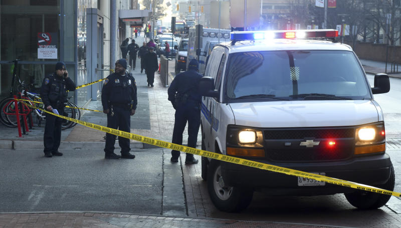 FILE - In this Monday morning, Feb. 4, 2019 file photo, Baltimore Police block off Penn Street at Lombard after a shooting at the University of Maryland Medical Center Shock Trauma in Baltimore. Baltimore broke its annual per capita homicide record after reaching 342 killings Friday, Dec. 27, 2019. With just over 600,000 residents, the city hit a historically high homicide rate of about 57 per 100,000 people after a week of relentless gunfire saw eight people shot three fatally in one day and nine others one fatally another day.  (Jerry Jackson/The Baltimore Sun via AP, File)