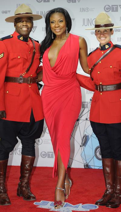 Jully Black shows off her curves in a gorgeous red wrap dress and silver bow sandal heels. THE CANADIAN PRESS/Sean Kilpatrick