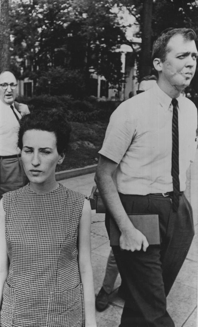 <p>Rita Schwerner, wife of missing civil rights worker Michael Schwerner, tried unsuccessfully in Jackson, Miss., to confer with Gov. Paul Johnson, June 25, 1964. At right is the Rev. Edwin King, chaplain of the predominately black Tougaloo College, and integration leader. In background far left is former welfare commissioner Fred Ross. (Photo: AP) </p>
