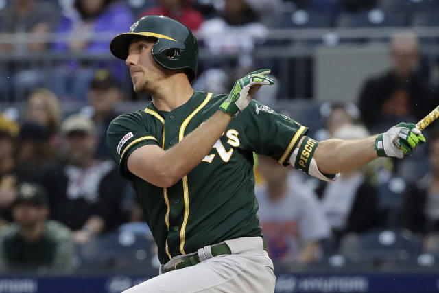 Oakland Athletics' Stephen Piscotty watches his RBI single off Pittsburgh Pirates starting pitcher Trevor Williams during the first inning of a baseball game in Pittsburgh, Saturday, May 4, 2019. (AP Photo/Gene J. Puskar)