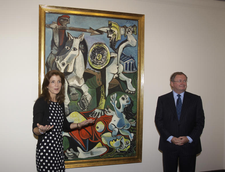 """Caroline Kennedy, president of the John F. Kennedy Library Foundation, and Malcolm Rogers ,of the Museum of Fine Arts in Boston, unveil Pablo Picasso's painting """"Rape of the Sabine Women"""" at the JFK Library and Museum in Boston, Thursday, Oct. 4, 2012. The painting is on loan to the library from the MFA in commemoration of the upcoming 50th anniversary of the Cuban Missile Crisis, which was Picasso's inspiration for the work. (AP Photo/Stephan Savoia)"""