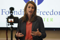 Victoria Cobb, of The Family Foundation, gestures during a news conference at the foundation offices in Richmond, Va., Tuesday, March 30, 2021. Cobb announced the filing of a lawsuit challenging the state Department of Education's newly issued guidelines on the treatment of transgender students. (AP Photo/Steve Helber)