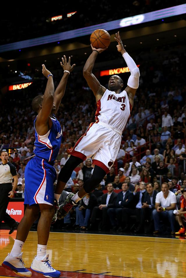 MIAMI, FL - NOVEMBER 07: Dwyane Wade #3 of the Miami Heat shoots over Chris Paul #3 of the Los Angeles Clippers during a game at AmericanAirlines Arena on November 7, 2013 in Miami, Florida. (Photo by Mike Ehrmann/Getty Images)