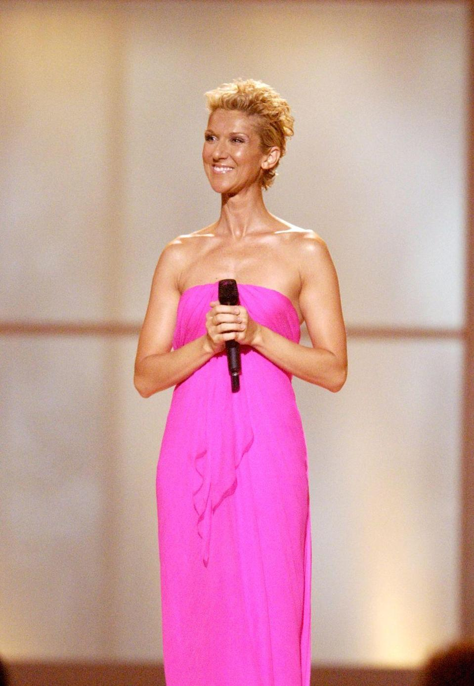 <p>Celine stepped out in a strapless fuchsia gown for the VH1 Divas Duets concert. The simple draping of the fabric make this dress ultra-flattering, and with few accessories, it has nothing to compete for your attention with.</p>