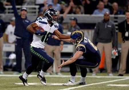Sep 13, 2015; St. Louis, MO, USA; Seattle Seahawks wide receiver Tyler Lockett (16) rushes past St. Louis Rams punter Johnny Hekker (6) and scores a 57 yard touchdown during the first half at the Edward Jones Dome. Mandatory Credit: Jeff Curry-USA TODAY Sports