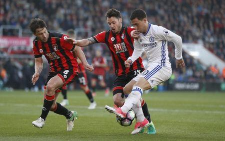Chelsea's Eden Hazard in action with Bournemouth's Adam Smith and Harry Arter