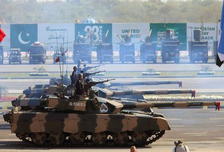 Soldiers drive Pakistan's Al Khalid tanks during Pakistan Day military parade in Islamabad, Pakistan