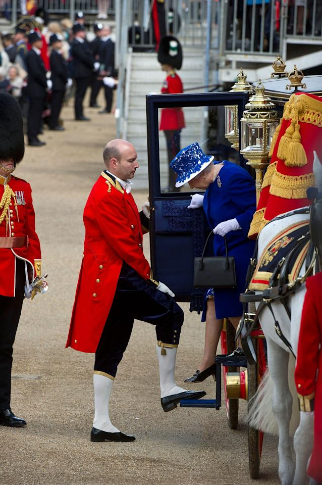 LONDON, ENGLAND - JUNE 15: Queen Elizabeth II arrives at the annual Trooping the Colour ceremony at the Horse Guards Parade on June 15, 2013 in London, England. Today's ceremony which marks the Queens official birthday will not be attended by Prince Philip the Duke of Edinburgh as he recuperates from abdominal surgery and will also be The Duchess of Cambridge's last public engagement before her baby is due to be born next month. (Photo by Bethany Clarke/Getty Images)