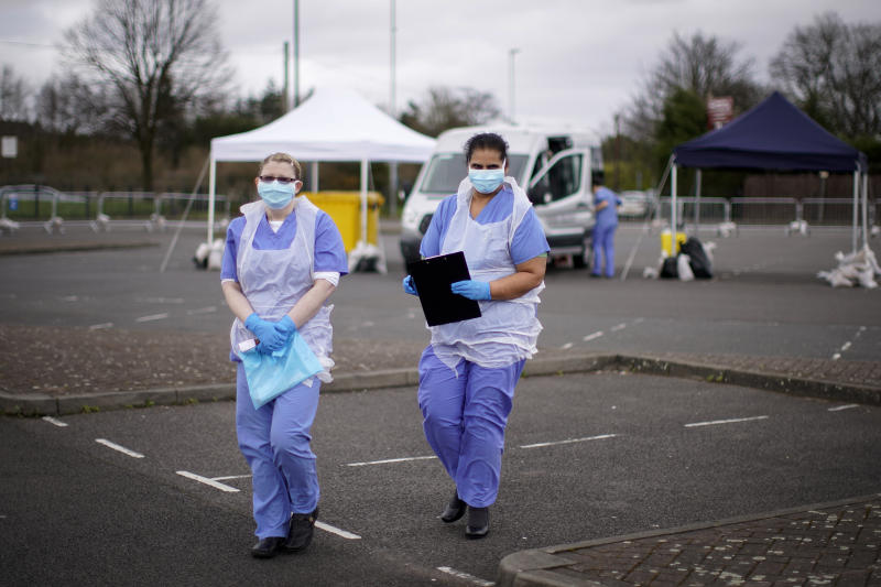 WOLVERHAMPTON, ENGLAND - MARCH 12: NHS nurses wait for the next patient at a drive through Coronavirus testing site in a car park on March 12, 2020 in Wolverhampton, England. The National Health Service facility has been set up in a car park to allow people with NHS referrals to be swabbed for Covid-19. (Photo by Christopher Furlong/Getty Images)