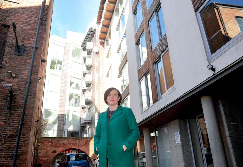 Rachael Loftus outside her apartment block in Leeds which has to pay for round-the-clock patrols or face a prohibition notice. (Photo: HuffPost UK/Donna Clifford)