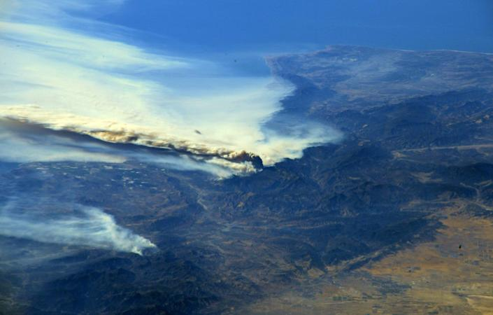 <p>A photo taken from the International Space Station and moved on social media by astronaut Randy Bresnik shows smoke rising from wildfire burning in Southern California, Dec. 6, 2017. (Photo: @AstroKomrade/NASA/Handout via Reuters) </p>