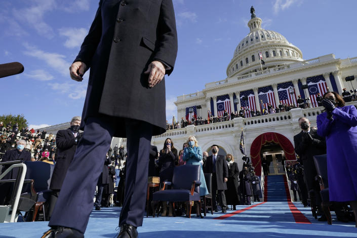 President Joe Biden walks to a podium to speak after he was sworn-in during the 59th Presidential Inauguration at the U.S. Capitol in Washington, Wednesday, Jan. 20, 2021. (AP Photo/Andrew Harnik, Pool)