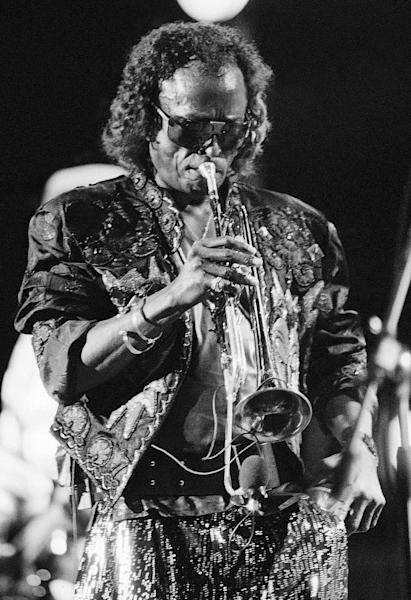 FILE - In this July 11, 1987 file photo, Miles Davis plays his trumpet during the annual North Sea Jazz Festival held in the Hague Netherlands. Fans of Davis and guitar master Jimi Hendrix have long known that the pair had been making plans to record together in the year before Hendrix's sudden death in 1970. But less attention has been paid to the bass player they were trying to recruit: Paul McCartney, who was busy with another band at the time. (AP Photo/Ton Pouw, File)
