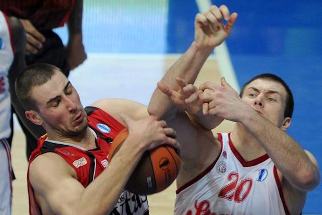 Lietuvos Rytas' Jonas Valanciunas (L) vies with BC Spartak Saint-Petersburg's Vladimir Dragicevic during Eurocup's FinalFour third place basketball match between Lietuvos Rytas and BC Spartak Saint-Petersburg in Khimki, a suburb of Moscow, on April 15, 2012. (Photo by Kirill Kudryavtsev /AFP/Getty Images)